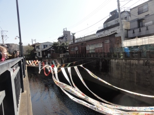 The dyed cloth strung along the river