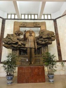Statue of Ho Chi Minh in the main hall of the museum dedicated to his memory and achievements.