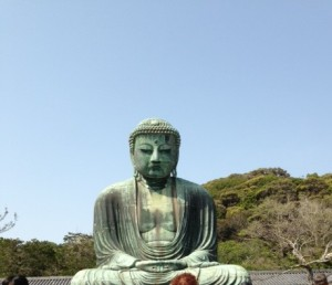 The Daibutsu Buddha set against the hillside backdrop