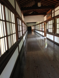 This is one of many long hallways. The monks in training clean the floors by hand without chemicals twice daily as part of their ritual.
