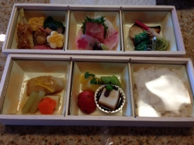 The bento lunch he brought for each person